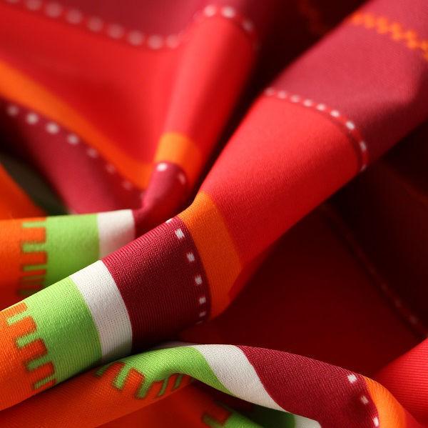 Badestoff glatt glänzend in rot orange grün gestreift